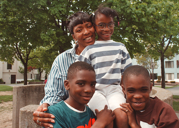 5/23/97--Johnetia Dix--Takaaki Iwabu photo-- Johnetia Dix gets together with her children, from left, Darius Dix, 6, Shannan Dix, 7. and Lametrius Gibson, 10, in front of her home  at Unity Park. (for Judy's story on Johnetia....)<br /> <br /> Feature, Thursday, BW