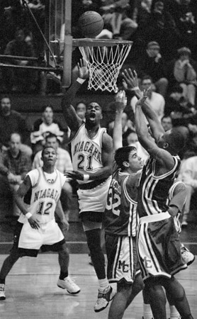 1/12/97--B&W HOOPS--CAPPY PHOTO-NU'S CHRIS WATSON GOES UP FOR THE JUMPER.