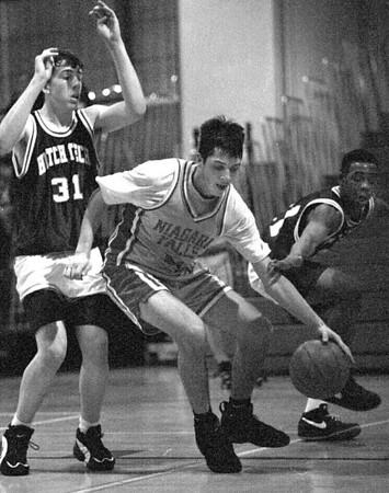 2/20/96--NF high basket 3--Tak photo--Dan Penale keeps a ball at the baseline.