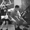 2/20/96--NF high basket 3--Tak photo--Dan Penale keeps a ball at the baseline.