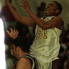 98/02/27--Lockport Basket--Takaaki Iwabu photo-- Lockport HS --------- (#31) goes up for a basket during the Friday's play-off game against Lacaster HS. <br /> <br /> photobin
