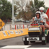 8/17/97--KMART/DARE RACE--DAN CAPPELLAZZO PHOTO--9-YR-OLD ELISE TJADEN, OF NF, AND KMART/DARE VOLUNTEER MATT FREY CROSS THE FINISH LINE DURING THE KMART RACE AGAINST DRUGS. THE 25 CITY TOUR (ALSO BEING HELD IN PITTSBURG AND CLEVELAND SUNDAY) RAISES MONEY FOR LOCAL DARE CHAPTERS.<br /> <br /> LCAL