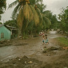 98/25/98 Honduras Relief 2 - Valerie E. Pillo Photo - Kids playing on Mud slide coverd street in La Ceiba, Honduras.