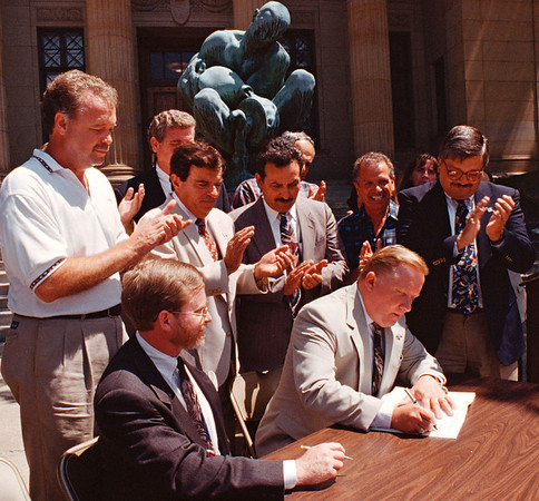 7/17/97--CITY HALL/COLOR--DAN CAPPELLAZZO PHOTO--MAYOR JAMES C. GALIE AND PRESIDENT OF THE NIAGARA FALLS REDEVELOPMENT CORP. BRIAN MEILLEUR SIGN A MASTER  REDEVELOPMENT AGREEMENT FOR THE DOWNTOWN AREA WITH ROUSING SUPPORT FROM CITY COUNCIL MEMBERS.<br /> <br /> 1A