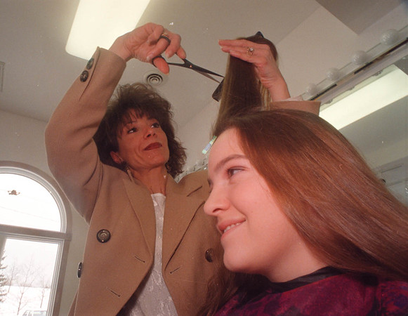 2/17/97 Francesca's hair Design - James Neiss Photo - Liz Young 15 of Youngstown has her hair cut by owner, Frances Gabriele.