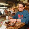 2/13/97 Joe Sinatra - James Neiss Photo - Sinatra's Resturant, Main Street. Resturant Owner Joe Sinatra is against banning smoking in restruants. Said about 90% of his customers are smokers.<br /> Bob Dritschel of Main Street has a cup of coffee in background.