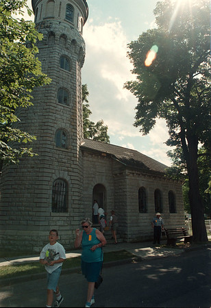 7/18/97 light house--Takaaki Iwabu photo-- Tourists walk in front of Fort Niagara Light House Friday. (for Don's story on ownership change of the House.)<br /> <br /> local, Saturday, bw
