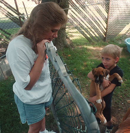 97/08/28 A Mothers Love 2 - James Neiss Photo - Tina Schenk and her son Richard Reiss 8yrs, likes playing with the new puppy.