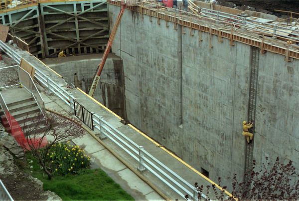 98/04/17 Working in Lock 35 *Dennis Stierer photo - A  worker checks one of the new ladders that was installed in the new wall area of Lock 35.