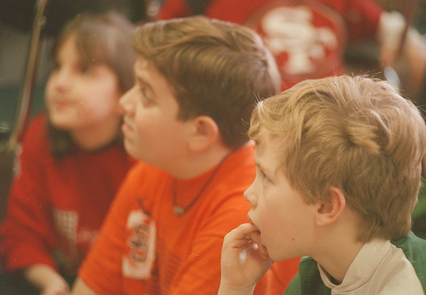 """98/02/02 Congressional Reading - James Neiss Photo -  L-R - Victoria Hamilton, Jeffrey Perri and David Wysocki all in Kathy Wright's Second Grade at Hyde park Elementary listen to congressman John LaFalce as he reads """"The Brontosaurus""""."""