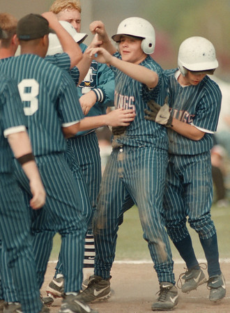 98/05/01-- baseball 1--Takaaki Iwabu photo-- Grand Island High School Chris Remus, center, comes in home after he hits a triple (plus error) against Niagara Falls High School Friday. <br /> <br /> color