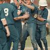 98/05/01-- baseball 1--Takaaki Iwabu photo-- Grand Island High School Chris Remus, center, comes in home after he hits a triple (plus error) against Niagara Falls High School Friday. <br /> <br /> color