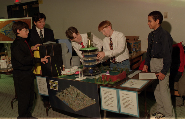 98/01/24 North Park City *Dennis Stierer photo - Students, (L-R) Dan McNeil, Julian Delloso, Jeff Siefert, Michael Bednarz, and Brice Carullo from North Park Middle School make some adjustments to their future City Display.