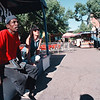 7/29/97--SUMMER FEST BUST--DAN CAPPELLAZZO PHOTO--(LTOR)CARNIES DAVID REEDER, OF MD., AND KASEY GLOSS, OF FERDONIA, SIT AT THE DUCK POND STAND WHILE FOR FAIR GOERS AT THE EMPTY EAST MALL ON THE FINAL DAY OF THE SUMMER FEST.<br /> <br /> LOCAL