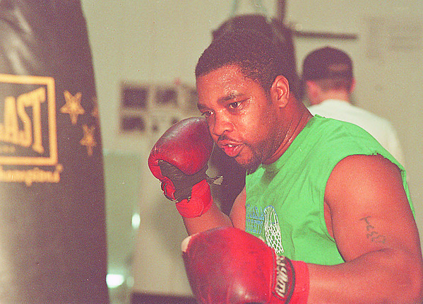 4/11/97-- boxer --Takaaki Iwabu photo-- Stacy Robertson, 28, practices using a punching bag at 13th Street Gym. He is one of the several local  boxers who are going to Golden Gloves. <br /> <br /> Monday, sports, color