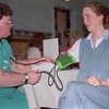"98/04/15 Brenzo Health-Rachel Naber Photo-(left) Bonnie Walsh, LPN for Medina memorial takes the blood pressure of Cindy Zinkievich at Bernzomatic""s Nutri Fair in Medina."