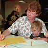 98/05/06 Off To School *Dennis Stierer Photo -Kindergarden registration was held at the Lockport Mall on Wednesday and  Mary Ellen Sylvis was registrating her son Levi who turns five May 18th for kindergarden next year at Charlotte Cross school.