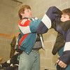 98/01/04--before the game--Takaaki Iwabu photo-- Frank Torcasio, a coach for Gui's Lumber, helps his son Frankie, 11, dress  golie's equipment before Sunday's game of Grand Niagara Hocky League at Niagara University. <br /> <br /> Grapevine photo