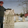 98/1/28 Warren corner2-Rachel naber-Floyd Yousey stand at the gravesite ogf the settlers of Warrens corners behind the barn on his farm in Warren's corners.