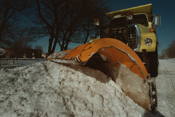 99/1/4 Snow Removal - Vino Wong Photo - City of Niagara Falls snow plow truck works its way along the 33rd Street and Walnut Avenue Monday.