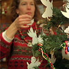 98/12/10 Angel Book Tree-Rachel Naber Photo-Sue Phillips  places paper angels on a tree  at the Book Shoppe in Medina that contain Christmas wishes for needy children to recieve books this holidy season. Customers can recieve a 10% discount if purchasing a book from the Book Shoppe for donation to Literacy Volunteers.