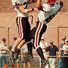97/10/04-- NW Falcons--Takaaki Iwabu photo-- Niagara-Wheatfield Jeff Schoonover and Frank Pavicich dance in the air as they celebrate Schoonover's touchdown, the Falcons' first score of the game against Sweet Home HS Saturday. <br /> <br /> Sunday, Sports, color