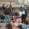 5/3/97-- bike auction-- Takaaki Iwabu photo-- Niagara Falls D.A.R.E. officer Daniel Jones holds up a bycicle as Lt. Vincent Johnson points out the buyer during the police bike-auction in front of Public Safety Building Saturday. <br /> <br /> local, Sunday, color