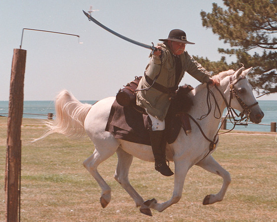 7/19/97--FT. NIAGARA--DAN CAPPELLAZZO PHOTO--WAR OF 1812 COMMON AMERICAN MALISSIA  DALE MUDRA SPEARS A RING ABOUT 3 INCHES IN DIAMETER OFF A HOOK WITH HIS SABRE AT A FULL GALLOP. THIS IS ONE OF MANY CAVALRY EXERSICES AT FT NIAGARA SATURDAY.<br /> <br /> LOCAL