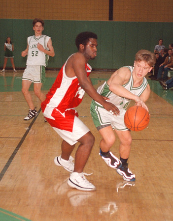1/28/97 NFHS at LewPort - James Neiss Photo - Niagara Falls High School at LewPort High School. #10 doug Jordan drives the ball for LewPort as #24 Cozell Ferrell for Niagara Falls tries to block.<br /> Basketball<br /> sports