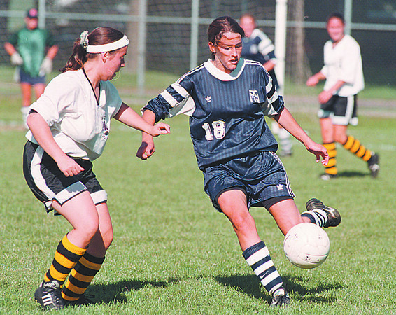 97/09/05--girls soccer--Takaaki  Iwabu photo-- NT Lumberjacks Kimberly Foster, right, cotrols a ball against LaSalle HS defense. <br /> <br /> sports, saturday, color