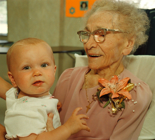7/25/97--Mary Polniak--Takaaki Iwabu photo-- A 107-year-old Mary Polniak holds her great granddaughter Jenna Stufkosky, 9-month, during her birthday party at Mount St. Mary's Nursing Home on Main Street Friday. (Additional info was faxed to Gazette, they said. She may be the oldest person in NF)<br /> <br /> grapevine photo