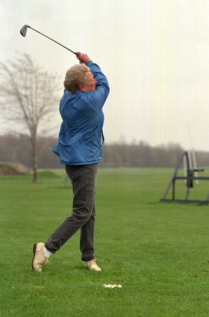 98/04/15 Great Form *Dennis Stierer photo - Doris Fabian of Lockport took advantage of the break in the rain to practice her golf swing near the County Golf Course.