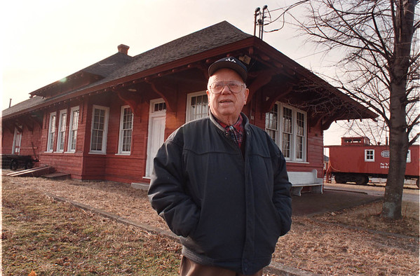 2/20/97-- train station --Takaaki Iwabu photo-- Don Croop, an honorary trustee of Wilson Historical Society, stands in front of old train station in Wilson.    ( ... for Sunday, Living)