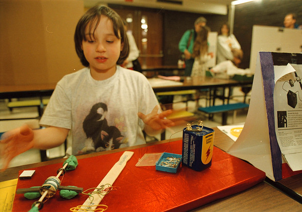 "3/15/97-- academic comp. --Takaaki Iwabu photo-- Sarah Robbins, 8, demonstrates her science project ""Magnetism and Electric Motors"" duirng the science competition in the Mini-Academic Olympics of City school children. <br /> <br /> 1B, Sunday, color"