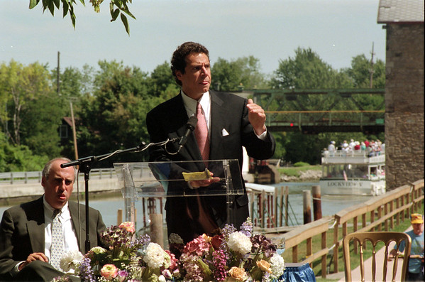 98/08/13 Cuomo on Canal-Rachel naber Photo-Dan Glickman (left) secretary of Agriculture listens to Andrew Cuomo, Secretary of Housing speak at the Lockport Locks and Canal cruises.