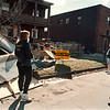 2/27/97-- wind accident 2 --Takaaki IWabu photo-- The roof of the building on Niagara St. and 30th St. got blown off and landed in front of the next-door aparment. (Looking on are the owners of the apartment)