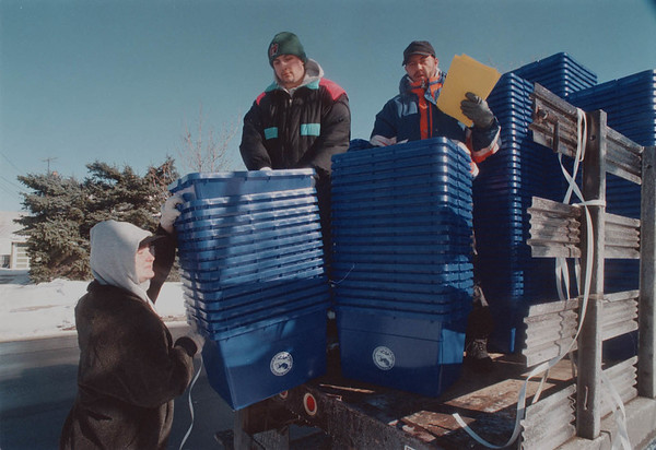 2/13/97 Recycling - James Neiss Photo - Recycling bins distributed by AmeriCorps members along 3500 block of Ferry Ave today. L-R are: Tina Purchner, Matt Rydelek and Ron Olfano, all of NF.<br /> <br /> AmeriCorps: Nancy Aikens 285-8224 Ext: 155