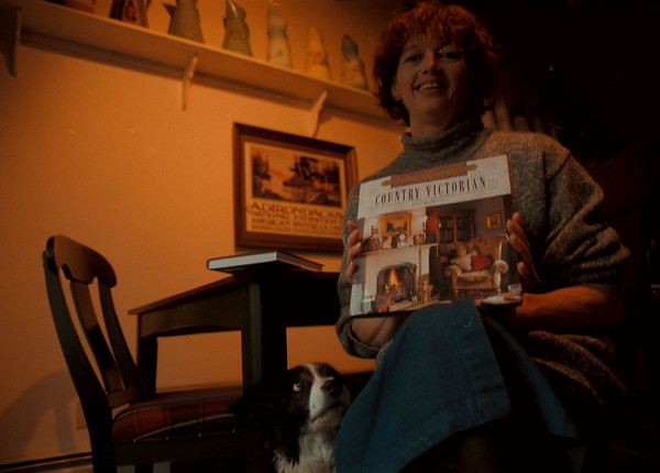 """97/11/21-- Ellen Plante --Takaaki Iwabu photo-- Ellen Plante, an author in Youngstown, holds one of her new books """"Country Victorian."""" <br /> <br /> feature, bw, Thursday, with promo"""