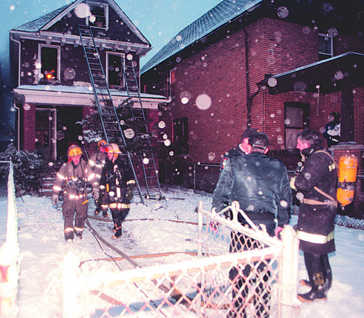 1/27/97--FATAL FIRE--DAN CAPPELLAZZO PHOTO--NF FIREFIGHTERS ACCESS FIRE DAMAGE AT 534 SIXTH STREET. TWO CHILDREN AND ONE ADULT WERE INJURED IN THE EARLY EVENING SMOKER.<br /> <br /> 1A