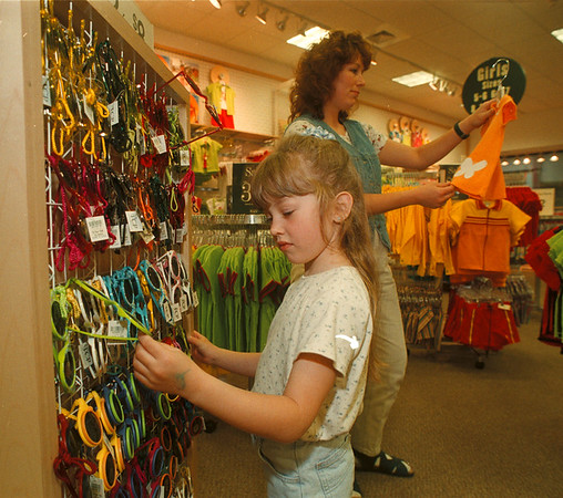 5/16/97 The Childrens Place - James Neiss Photo - Maura Van Leeuwen 5yrs looks at sunglasses as mom, Laurie VanLeeuwen looks a cloths at the Childrens Place newly opened at the Factory outlet mall.