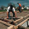 98/04/22--91st park--dan cappellazzo photo--dpw sidewalk divison's john soro levels the corner of the foundation for a new shed at 91st park, as fellow worker rich keller helps out.<br /> <br /> 1a firday