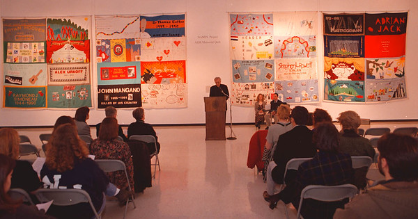 2/9/97--AIDES QUILT/CASTELANNI--DAN CAPPELLAZZO PHOTO--REV. PAUL GOLDEN, C.M.  PRESIDENT OF NIAGARA UNIV. HOLDS MASS IN FRONT OF THE AIDES QUILT AT THE CASTELLANI ART MUSEUM, N.U. CAMPUS.