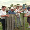 98/07/27 Shawnee Field Days *Dennis Stierer Photo -<br /> The Shawnee Volunteer Fire Co is having it's 51st annual Field Days on July 31st and Aug 1st. Helping to set up fencing are Carl Greene,III;  Neil Haseley, Chairman of the event; Nathan Scoville; and Al Case.<br /> SEE ADDITIONAL INFO ATTACHED.........