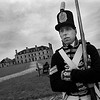1/5/97--FORT/GRAY DAY--DOUG DeCROIX, DRESSED AS A ROYAL REGIMENT OF ARTILLARY WAR OF 1812, STANDS HIS POST ATA SNOWLESS  FORT NIAGARA. DeCROIX SIAD IT IS COLDER BY THE LAKE BUT FOR THIS TIME OF YEAR HE WASN'T COMPLAINING.<br /> <br /> LOCAL