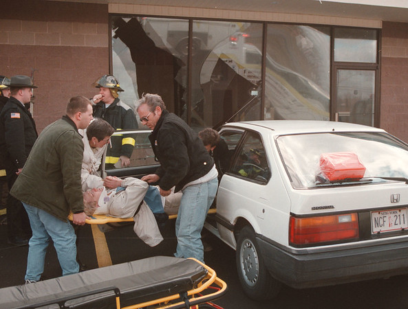 98/03/05 Accident - James Neiss Photo - A woman drove her car into an empty store front at the Rotella Square Plaza at 8875 Porter Rd at the corner of 4th Ave. Town of Niagara volunteer fire companies Niagara #1 and Active hose both responded.