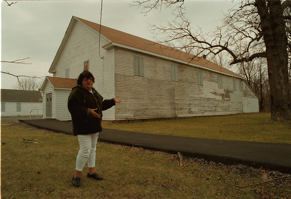 98/12/03 Community Building - James Neiss Photo - Tuscarora Reservation native Rosemary Hill shows off the old gym that's being used as a community building. She's trying to gain support for a new community center on the reservation.