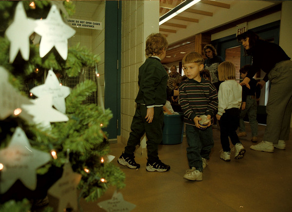 97/12/02-- SPCA--Takaaki Iwabu photo-- Eric Berg holds cans of cat food as he and other students from YWCA of Tonawanda visited Niagara County SPCA Tuesday. They brought basket of munchies to the animals as Pre-school and Kinder Korner Project. <br /> <br /> grapevine photo
