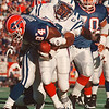 97/09/21-- Bills, 1A--Takaaki Iwabu photo-- Buffalo Bills Lonnie Johnson drags Indiana Colts defense after he caught a short pass from Todd Collins during the second quarter of the game Sunday at Rich Stadium. Johnson scored the Bills first TD a few plays after.