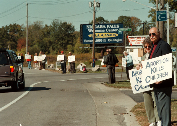 98/10/04 National Life Chain *Dennis Stierer Photo -<br /> Lillian and Richard Pearce (far right), from Pendleton were among the hundreds that stood along Niagara Falla Blvd. in a life chain proclaiming the simple reminder that 'Abortion Kills Children'.