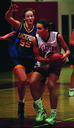 98/01/20--NW/LKPT GIRLS HOOPS--DAN CAPPELLAZZO PHOTO--LKPRT'S HEATHER CAMPBELL TRIES TO SHUT DOWN N.W.'S CHRISSY MILLEVILLE IN SCEOND HALF ACTION. MILLEVILLE HAD 16 PTS.<br /> <br /> SP